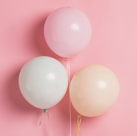balloons on pink background